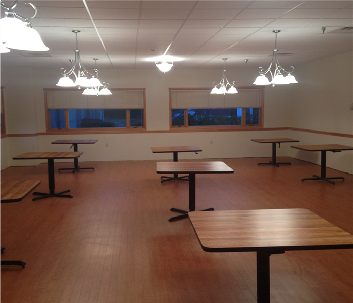 The same dining roomrestored to its original form following SERVPRO's drying and re-construction skills