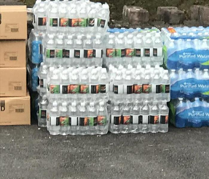 Cases of SERVPRO labeled water we donated for the Ronald McDonald House
