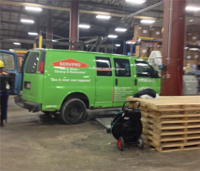 A SERVPRO truck parked inside a local manufacturing facility