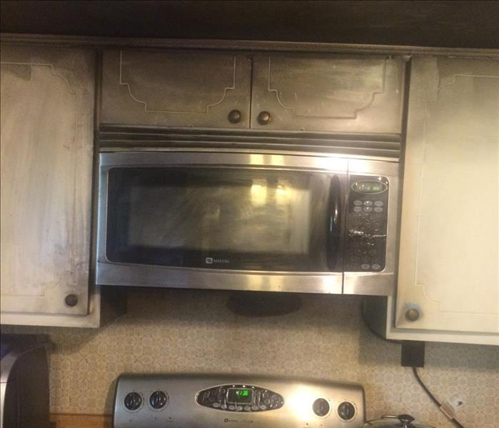 A fire damaged kitchen stove and range